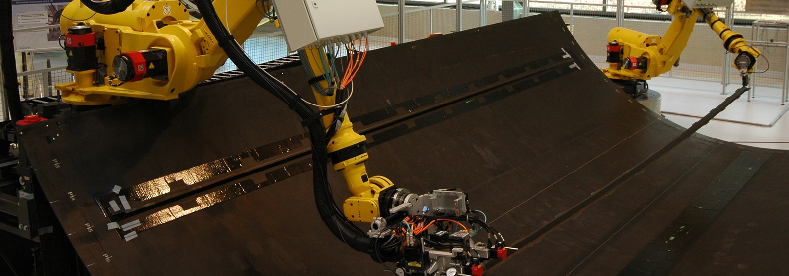 R-2000 robot bonding stringers into a composite structure