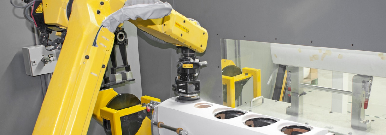 Robot polishing surfaces of speaker cabinets