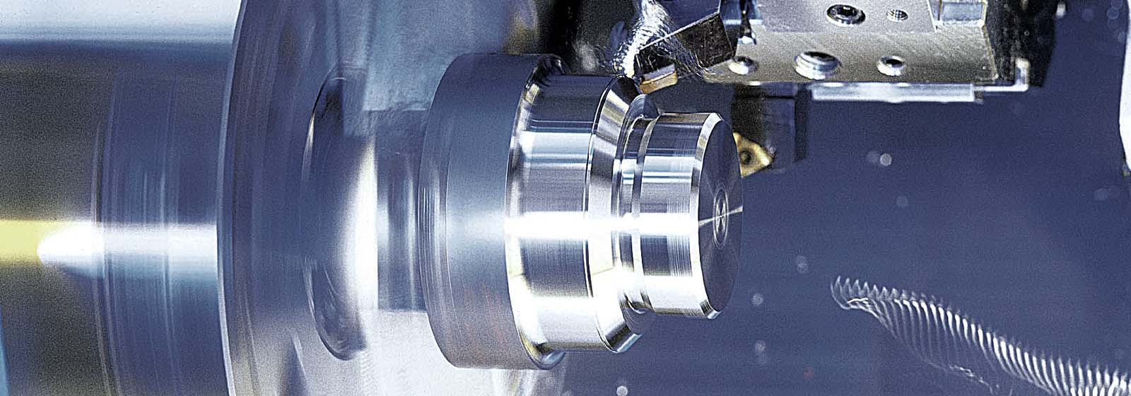 CNC machine turning metal workpiece
