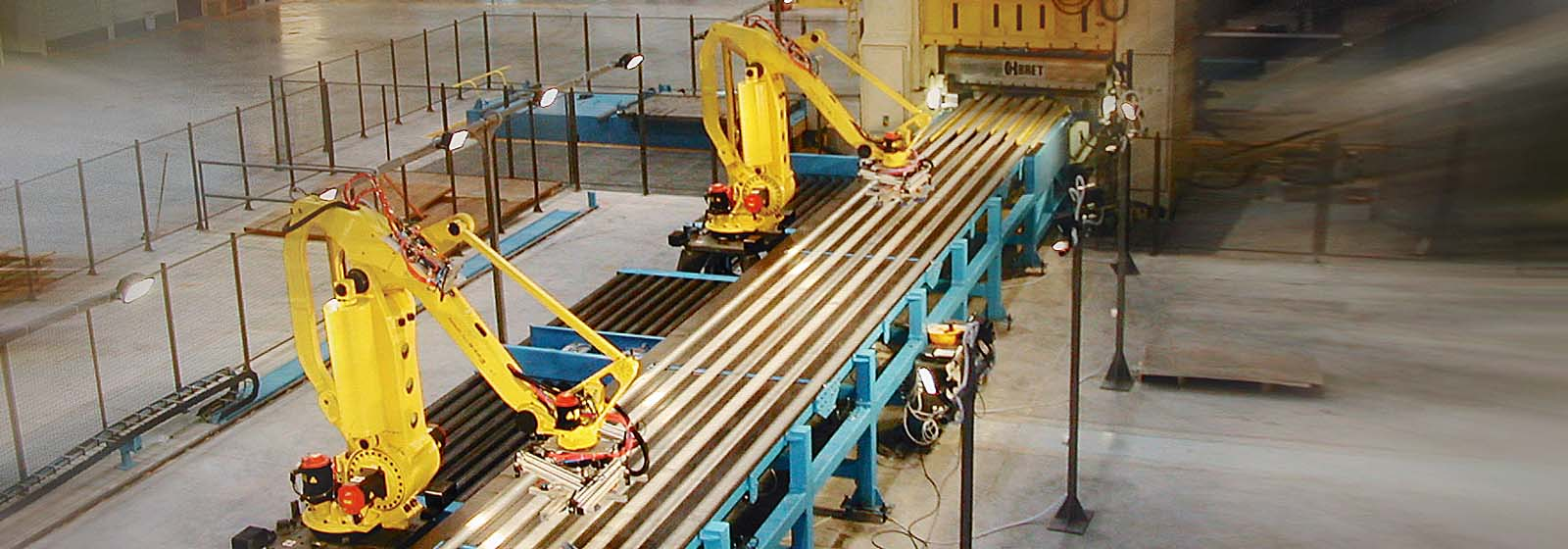 Two M-410 robots handling large metal sheets