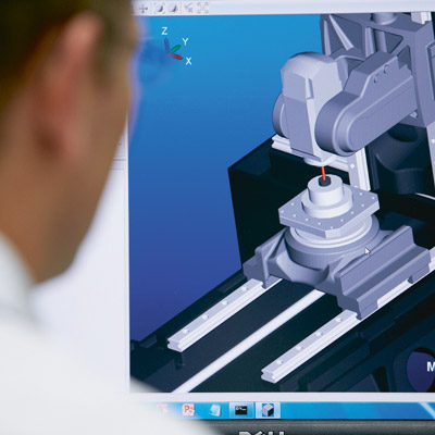 Operator working with cnc control software