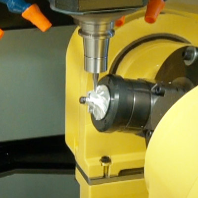 Robodrill milling a piece of metal situated on rotary table