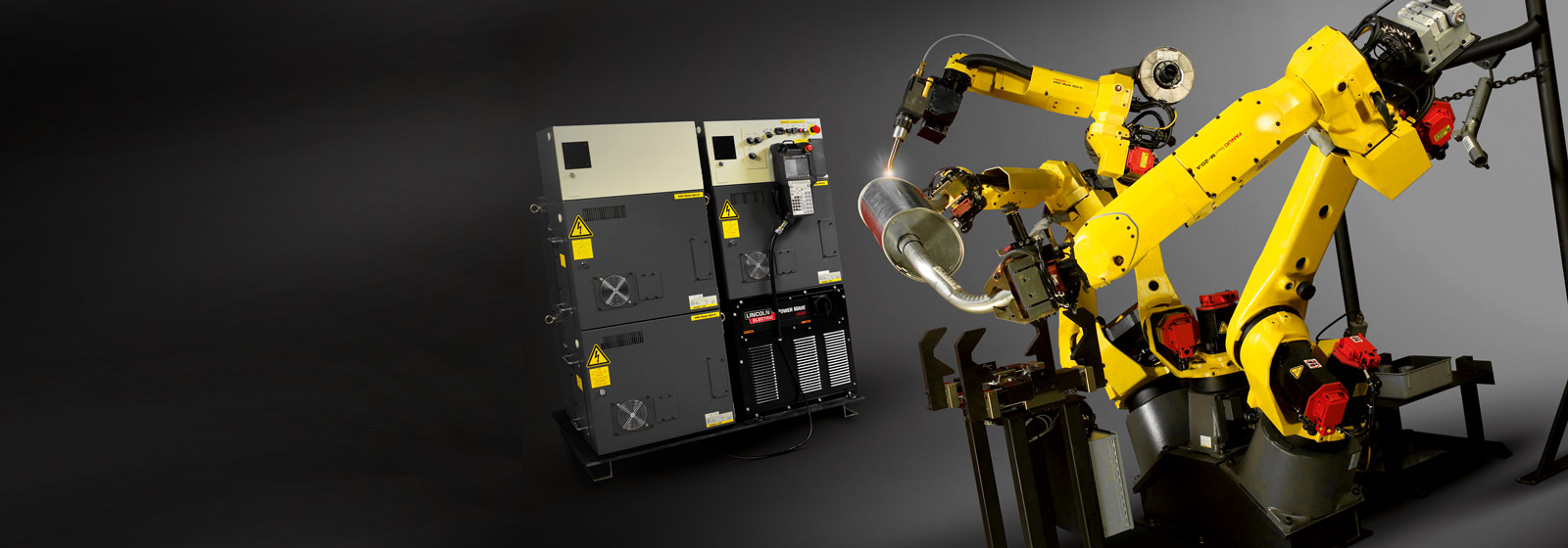 Three welding robots and control units