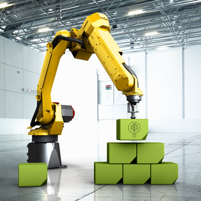 robot stacking green cases in industrial hall