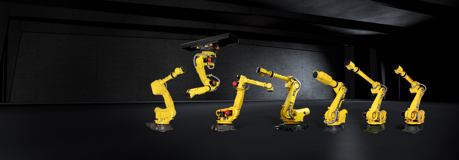 7 R-2000 industrial robots in industry hall
